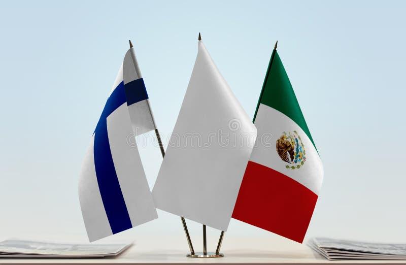 芬兰和墨西哥的旗子 库存照片