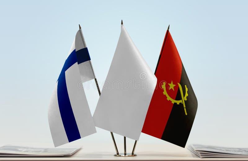 芬兰和安哥拉的旗子 库存照片