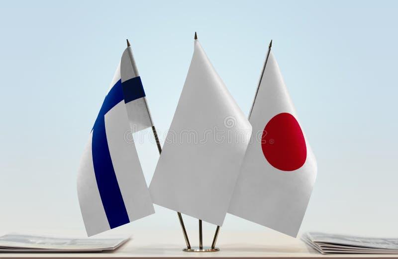 芬兰和日本的旗子 库存照片
