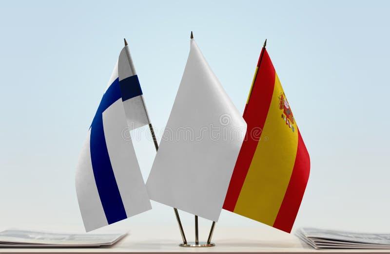 芬兰和西班牙的旗子 库存照片
