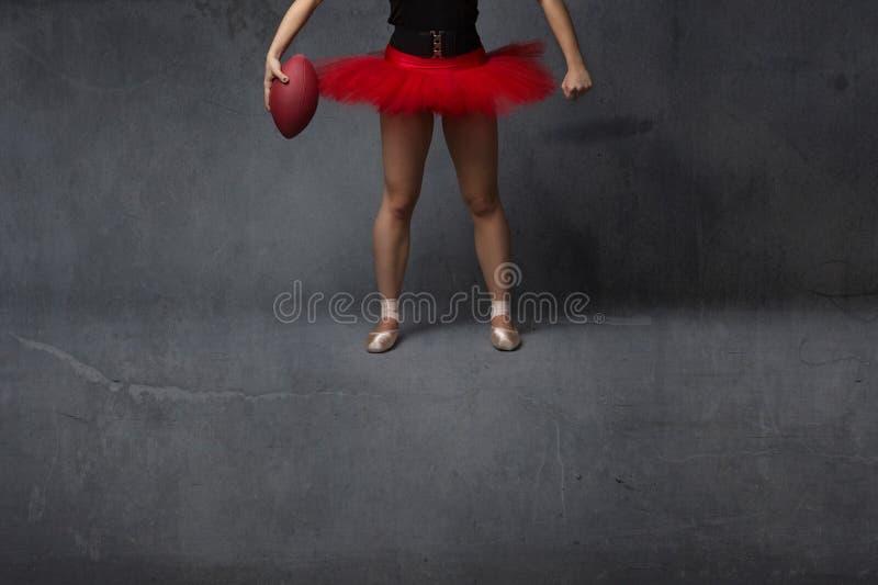 芭蕾舞女演员或足球运动员关闭 免版税库存图片