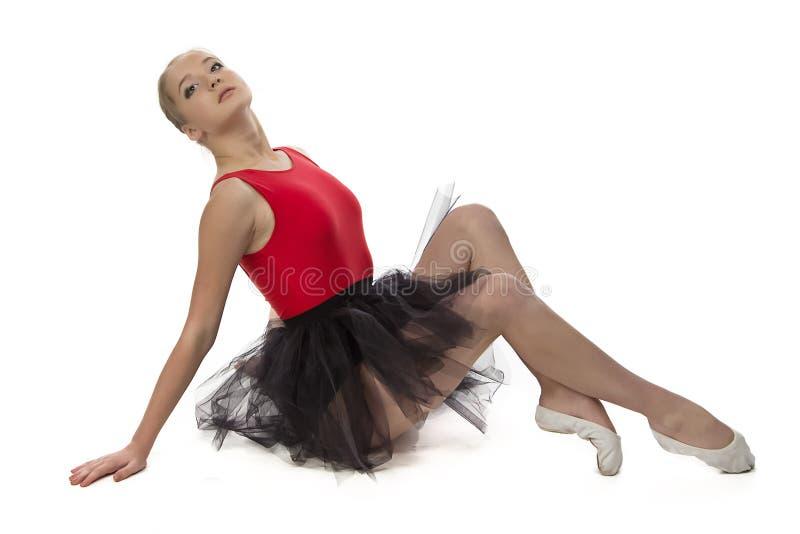 年轻芭蕾舞女演员的图象坐地板 库存图片