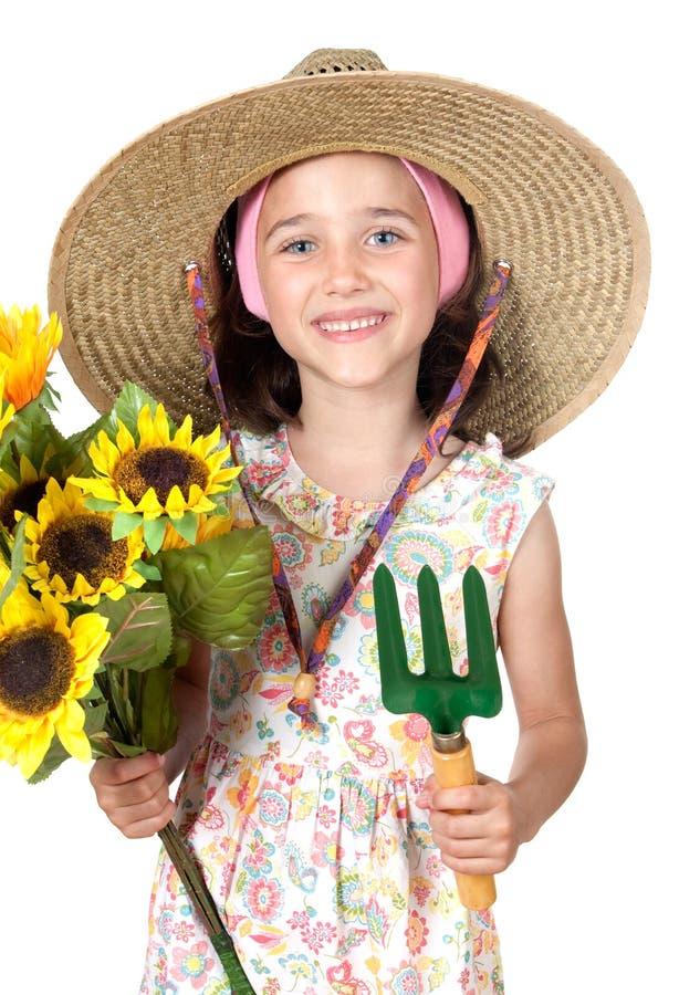 花匠女孩帽子少许秸杆 免版税库存照片