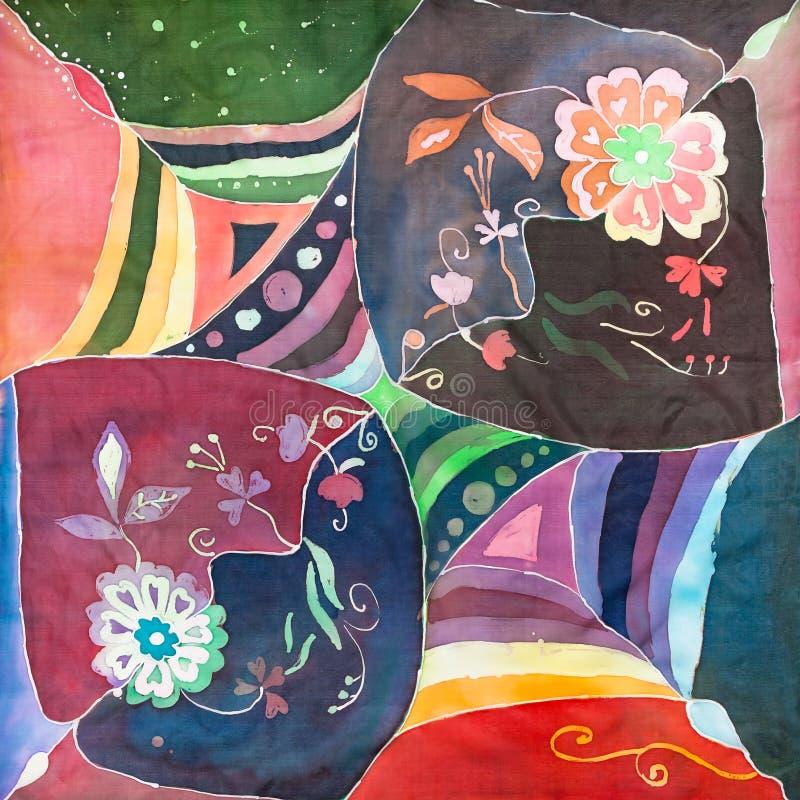 花卉样式在手边被绘的蜡染布头巾 免版税库存照片