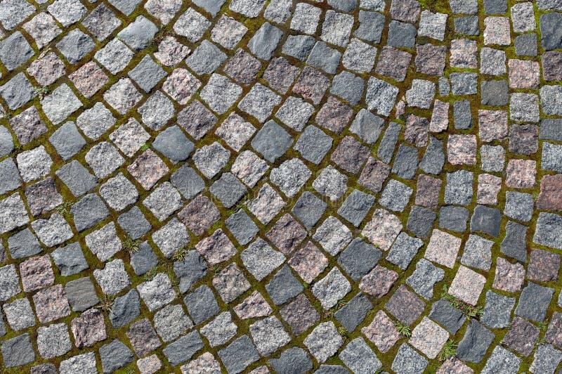 花岗岩石头的路面 老鹅卵石路路面纹理, 免版税库存图片