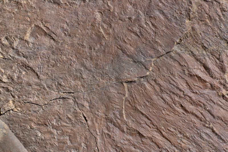 花岗岩石头肮脏的纹理 免版税库存图片