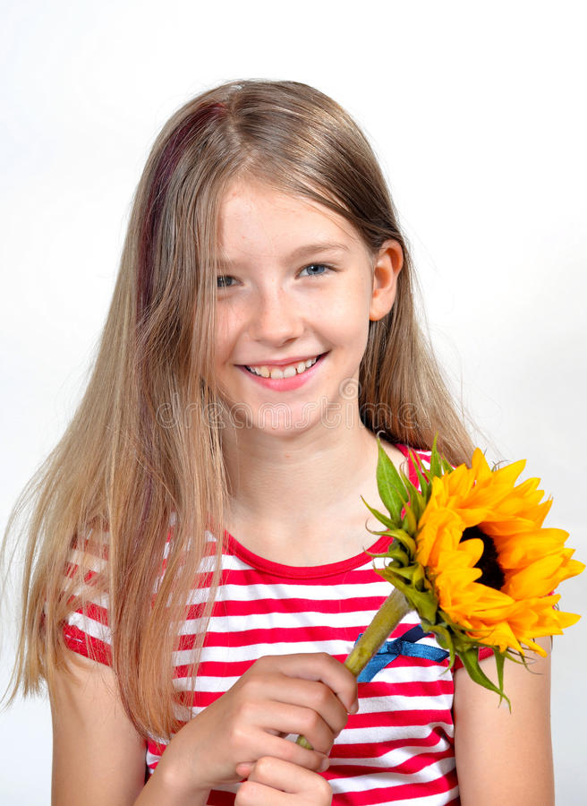 花束花滑稽的女孩 库存图片