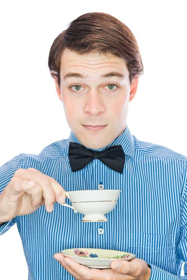 花梢英俊的古板的绅士饮用的茶 库存照片