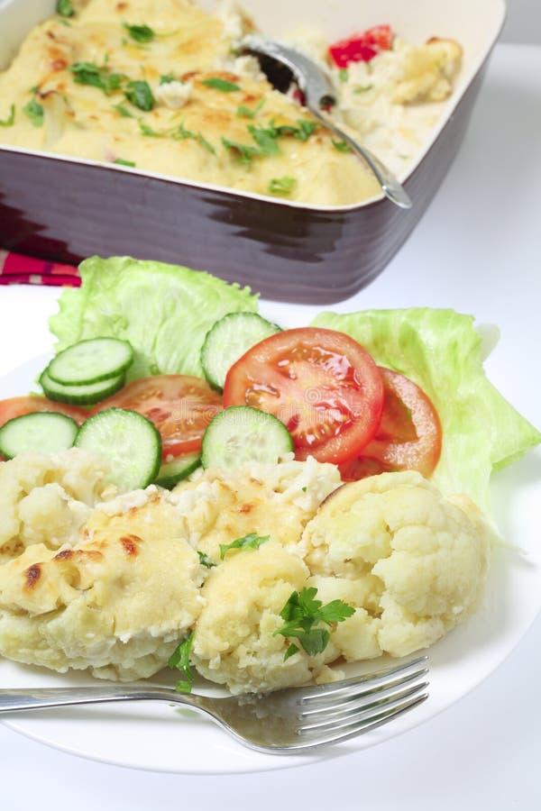 花椰菜干酪膳食垂直 库存图片