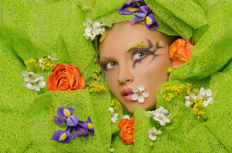 花的美丽的妇女 图库摄影