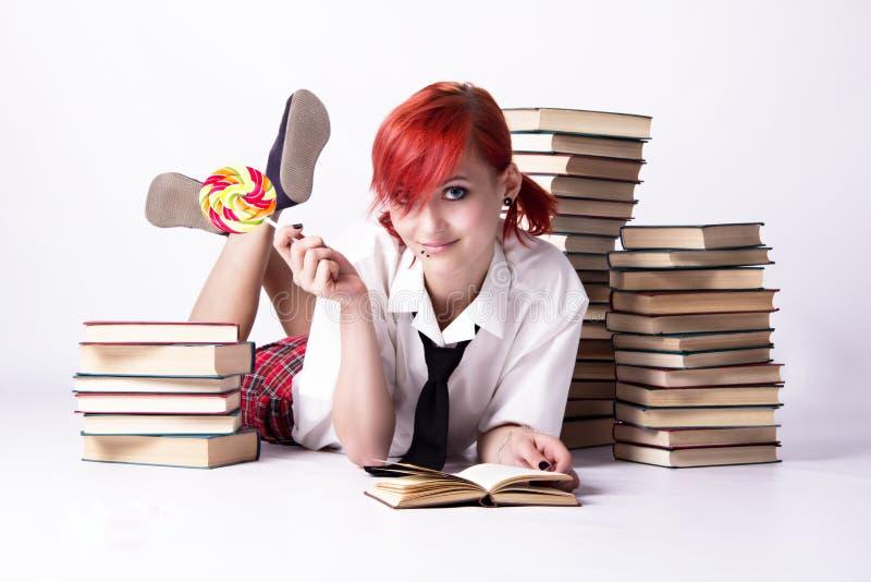 芳香树脂样式的女孩用糖果和书 免版税库存图片