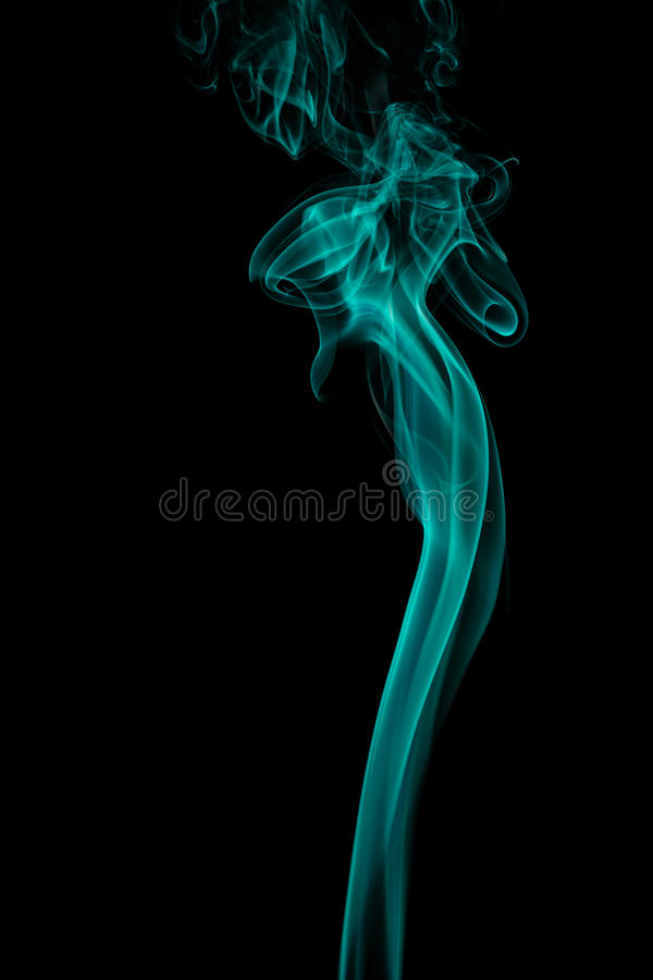 从芳香棍子的抽象蓝绿色烟 库存图片