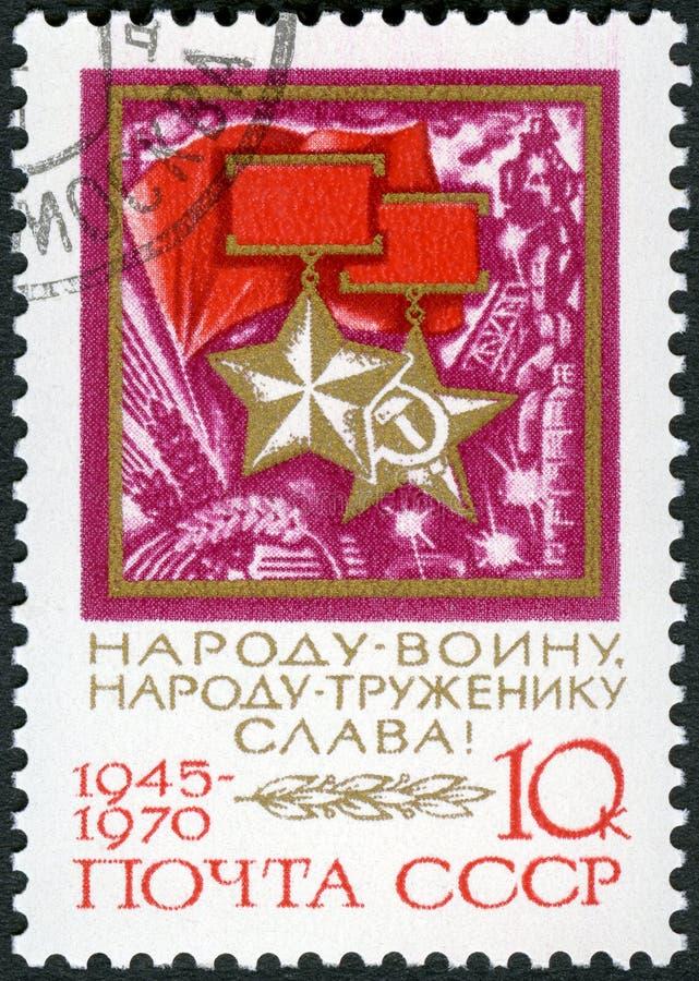 苏联- 1970年:展示社会主义者劳方英雄的苏联和奖牌等级的金星  库存照片