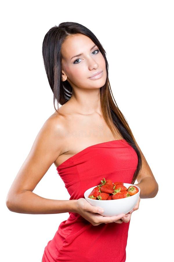 苗条新深色的holdng草莓。 免版税库存图片
