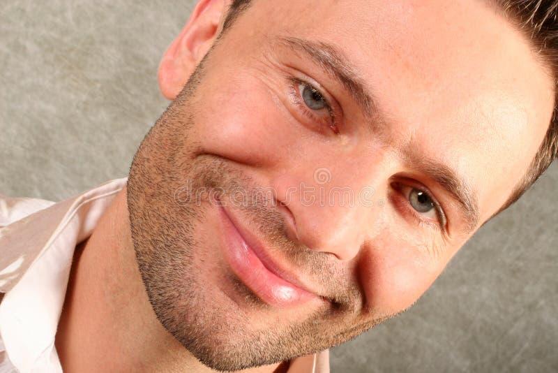 英俊人微笑 库存图片