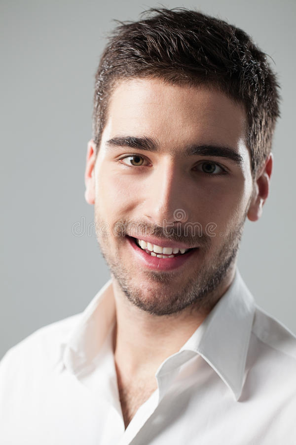 英俊人微笑 免版税图库摄影