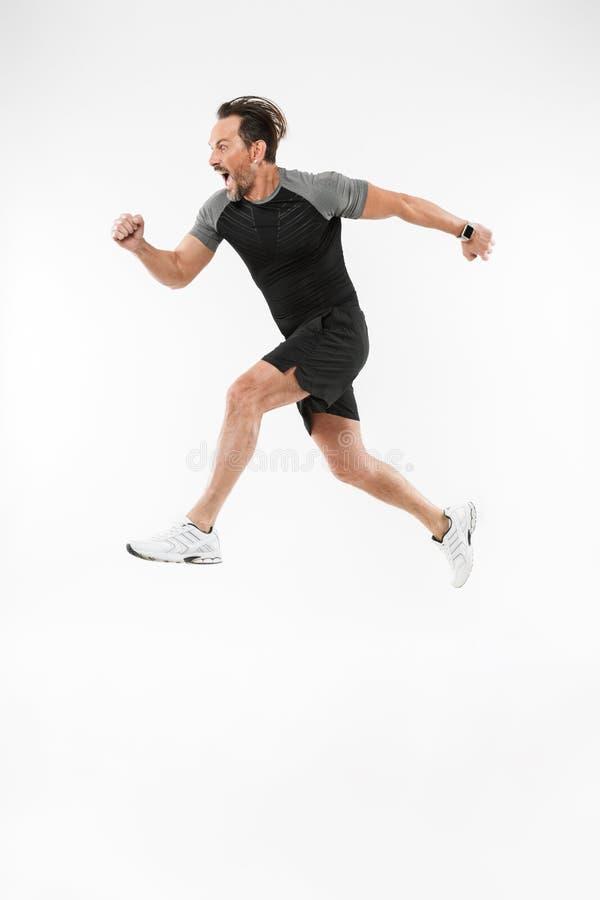 英俊的严肃的成熟运动员赛跑 图库摄影