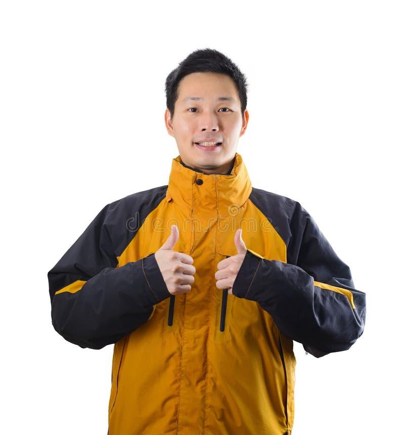 英俊的亚裔人穿戴了与在白色背景的冬天衣物 免版税图库摄影
