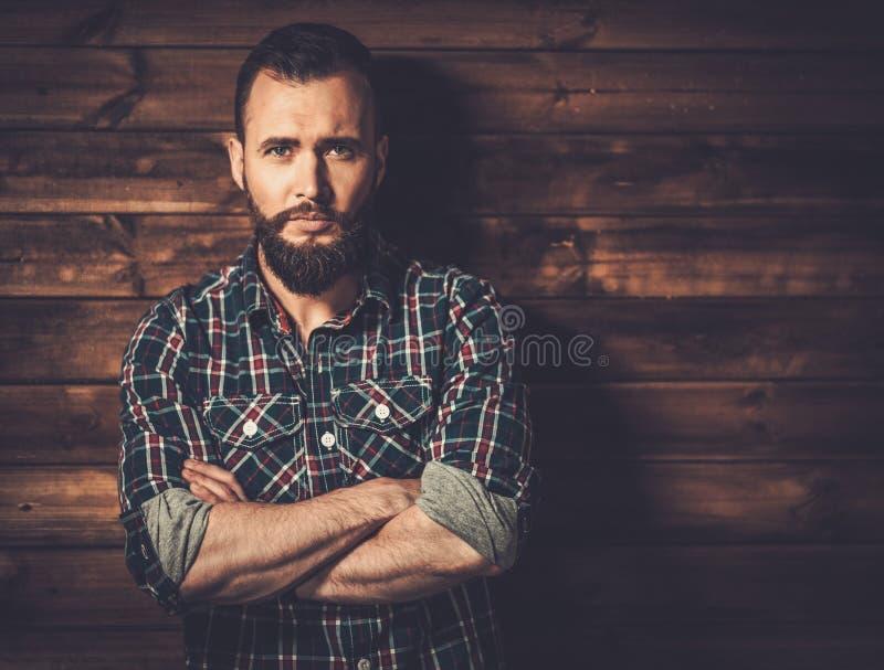英俊的人佩带的方格的衬衣 图库摄影