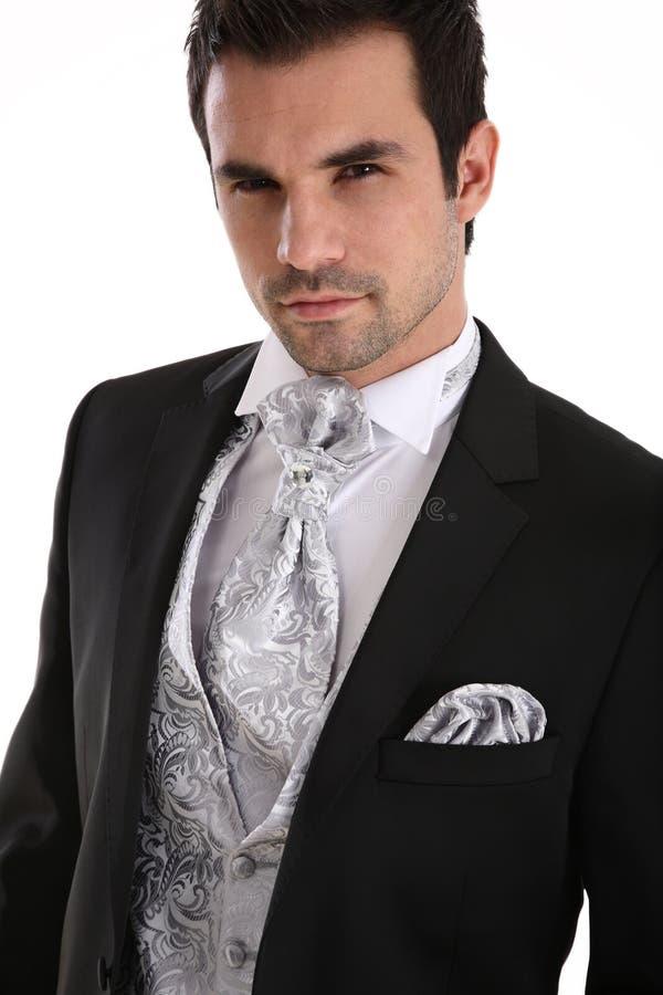 英俊的人无尾礼服年轻人 库存图片
