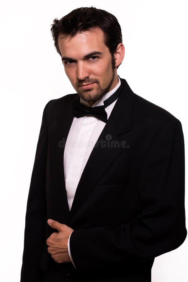 英俊的人无尾礼服 库存图片