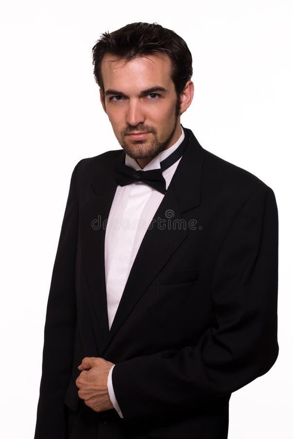 英俊的人无尾礼服 免版税库存照片