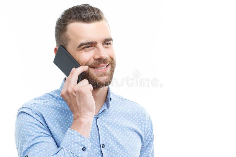 英俊的人谈话每个手机 免版税库存照片