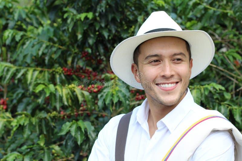 英俊的农夫在咖啡种植园 免版税图库摄影