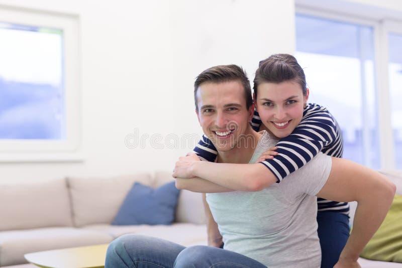 英俊的女朋友扛在肩上他的人 图库摄影