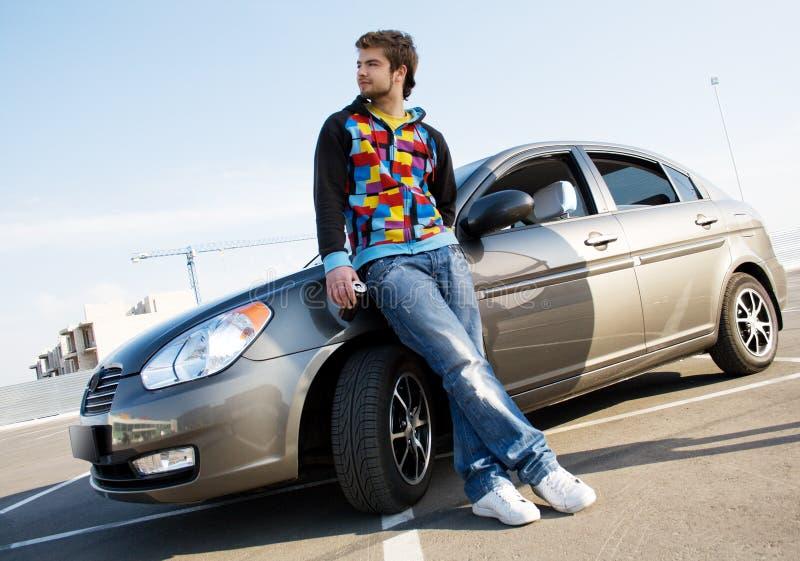 英俊的汽车他的新的人 图库摄影
