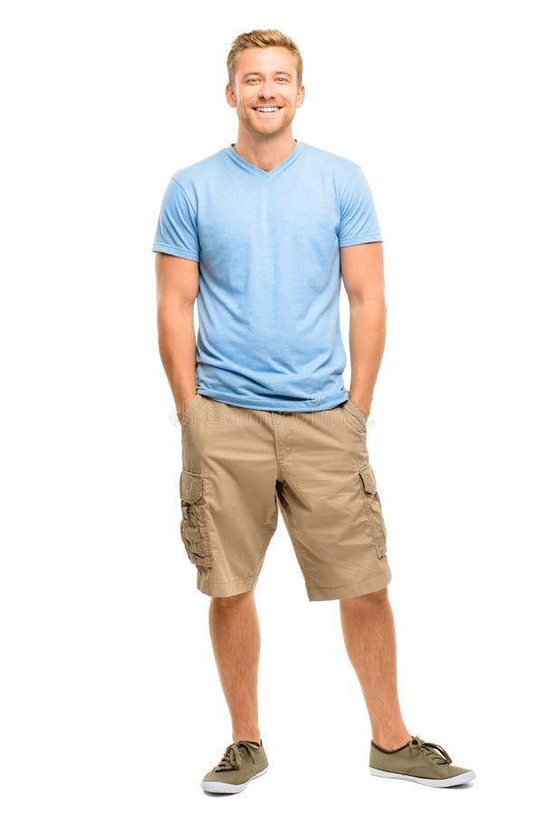 英俊的年轻人微笑的全长白色背景 免版税库存图片
