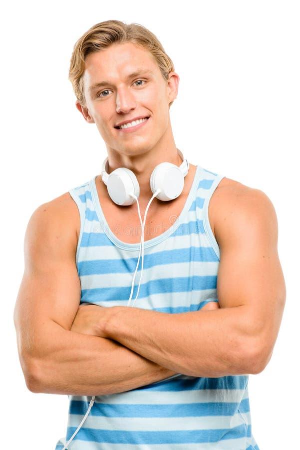 英俊的年轻人微笑的胳膊在白色backgro折叠了隔绝 免版税图库摄影