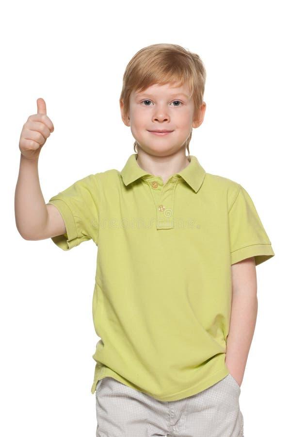 英俊的年轻男孩显示他的赞许 库存图片