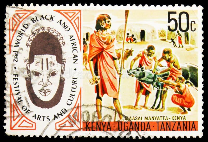 英国东非(肯尼亚、乌干达和坦噶尼喀)印有的邮票显示Maasai Manyatta — 肯尼亚,艺术节和 免版税库存图片