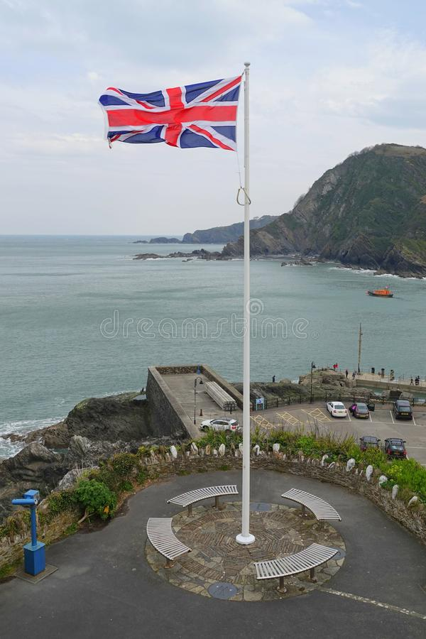 英国国旗在旗杆的旗子飞行 免版税库存照片