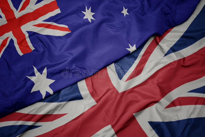 英国的挥动的五颜六色的旗子和澳大利亚的国旗 库存照片