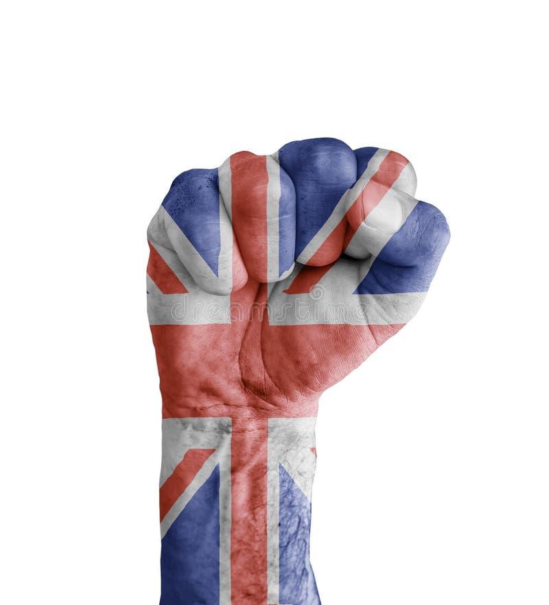 英国的旗子在象胜利的人的拳头绘了 免版税库存照片