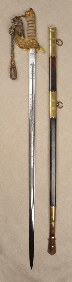 英国皇家海军官员的剑刀柄 免版税库存照片