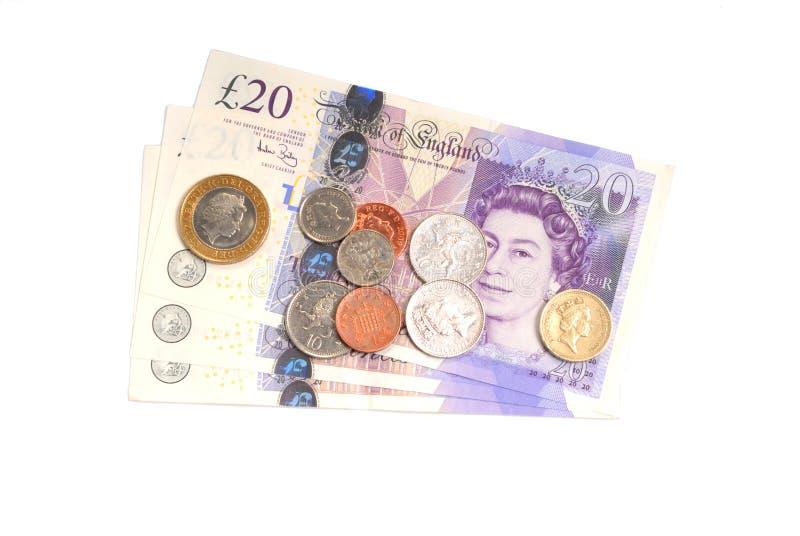英语钞票的硬币 免版税库存照片