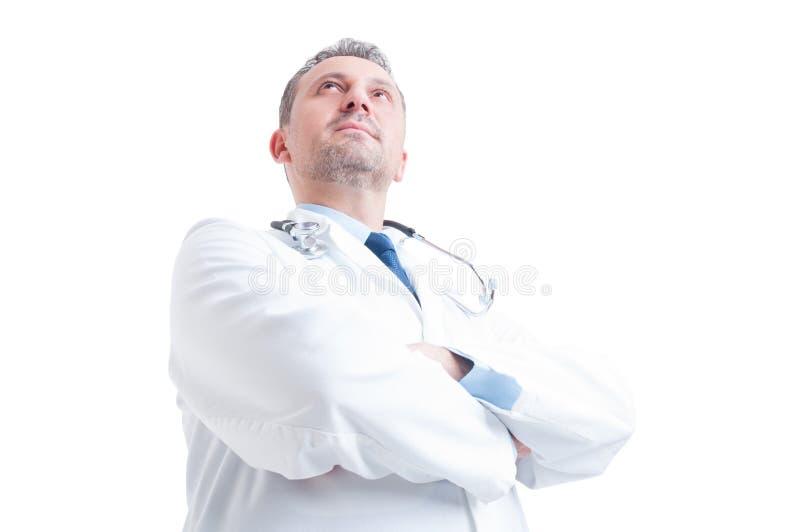 英雄在年轻医生或军医低角度射击了  免版税库存图片