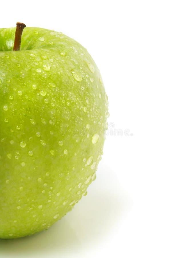 苹果丢弃新鲜的绿色半水 免版税库存图片