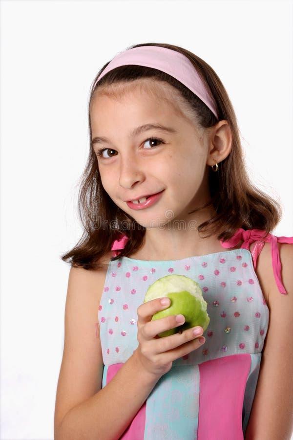 苹果儿童女孩绿色年轻人 免版税库存照片