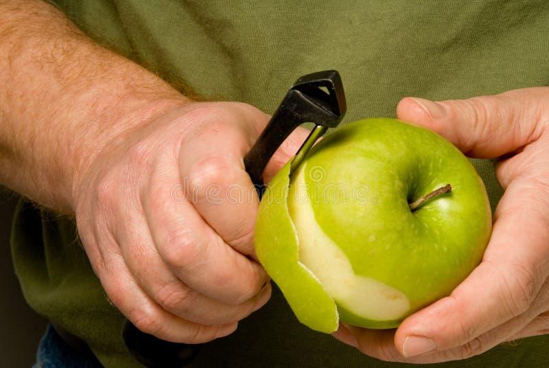 苹果削皮 免版税库存照片