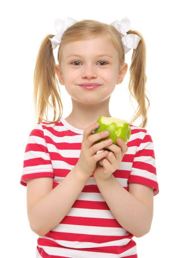 苹果吃女孩绿色微笑 库存照片