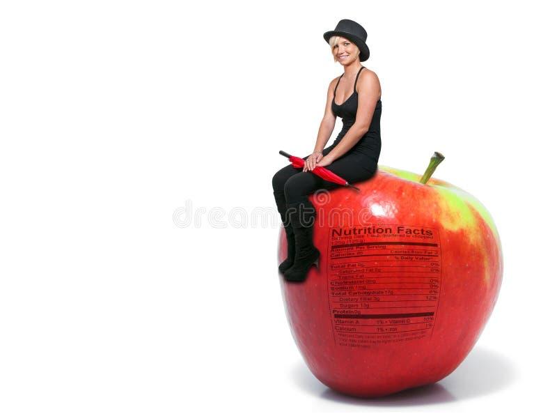 苹果坐的妇女 免版税库存图片