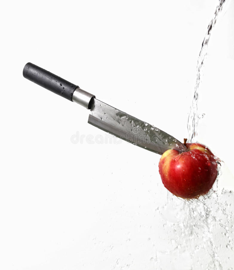 苹果埋置了刀子 免版税图库摄影