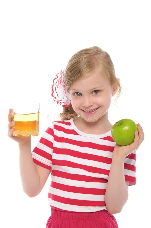 苹果女孩愉快的汁液 图库摄影