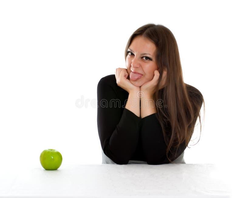 苹果女孩绿色显示的舌头 库存照片