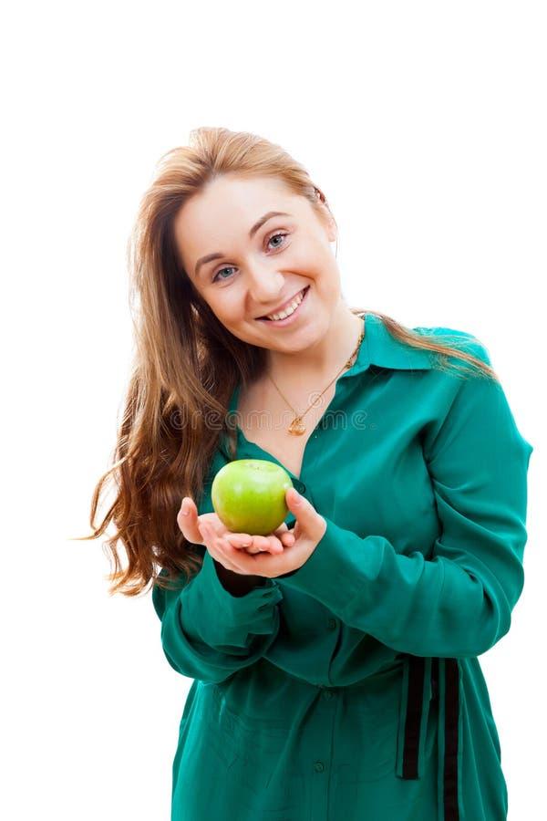 苹果女孩绿色微笑 免版税库存照片