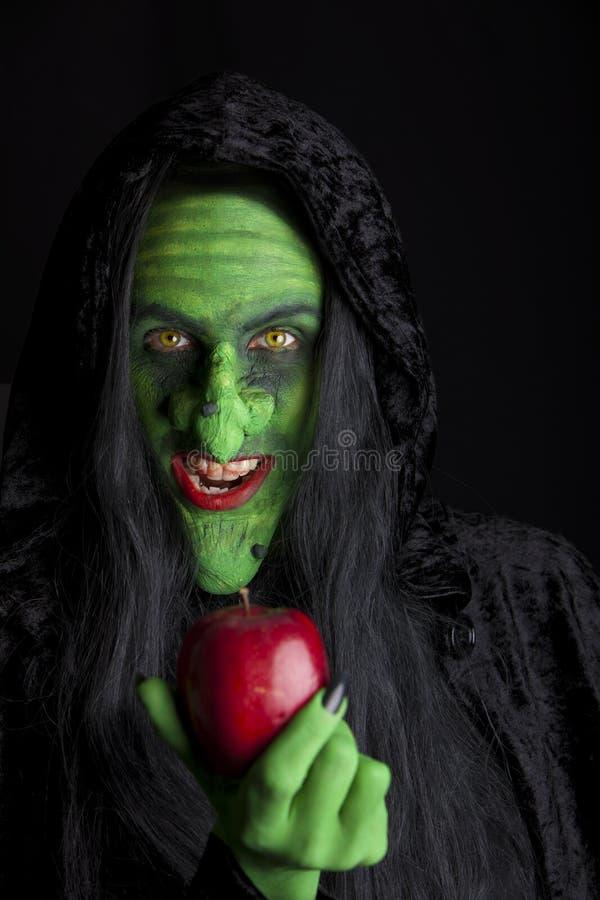 苹果她的毒巫婆 免版税库存照片